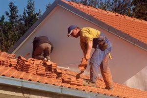roofers installing tile roof