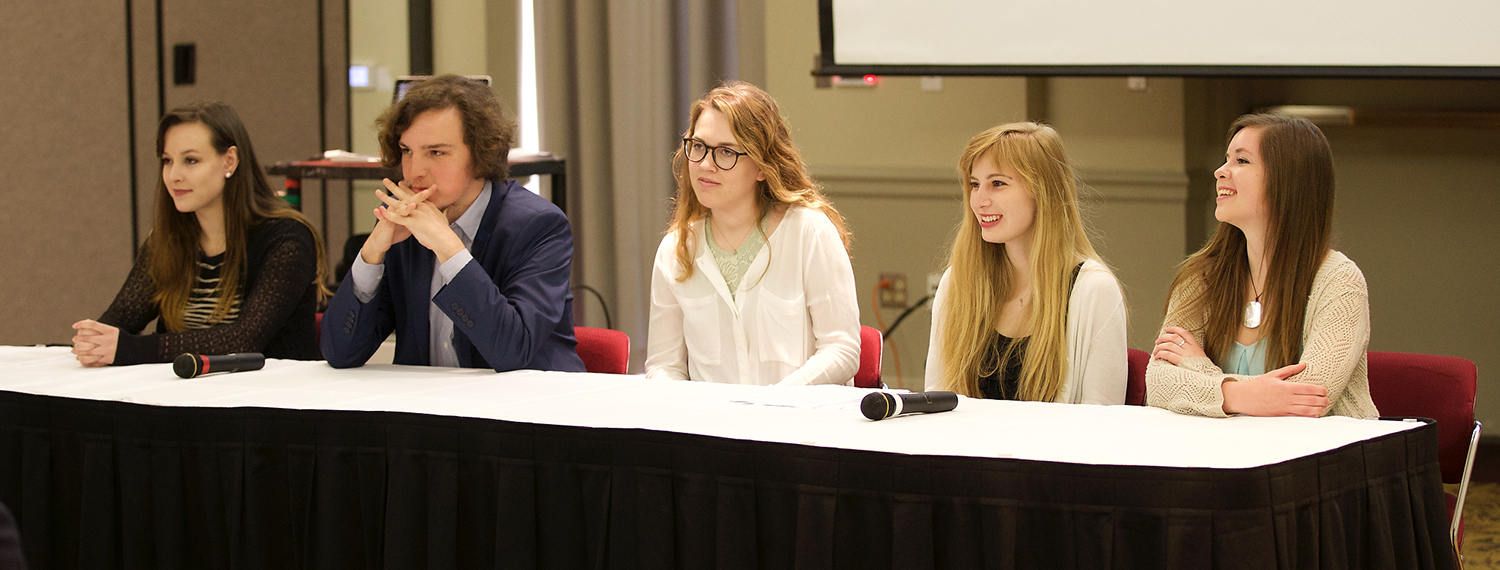 Five undergraduate Altman Scholars at a symposium answering audience questions
