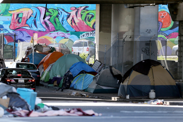 Tent city under a a freeway over pass