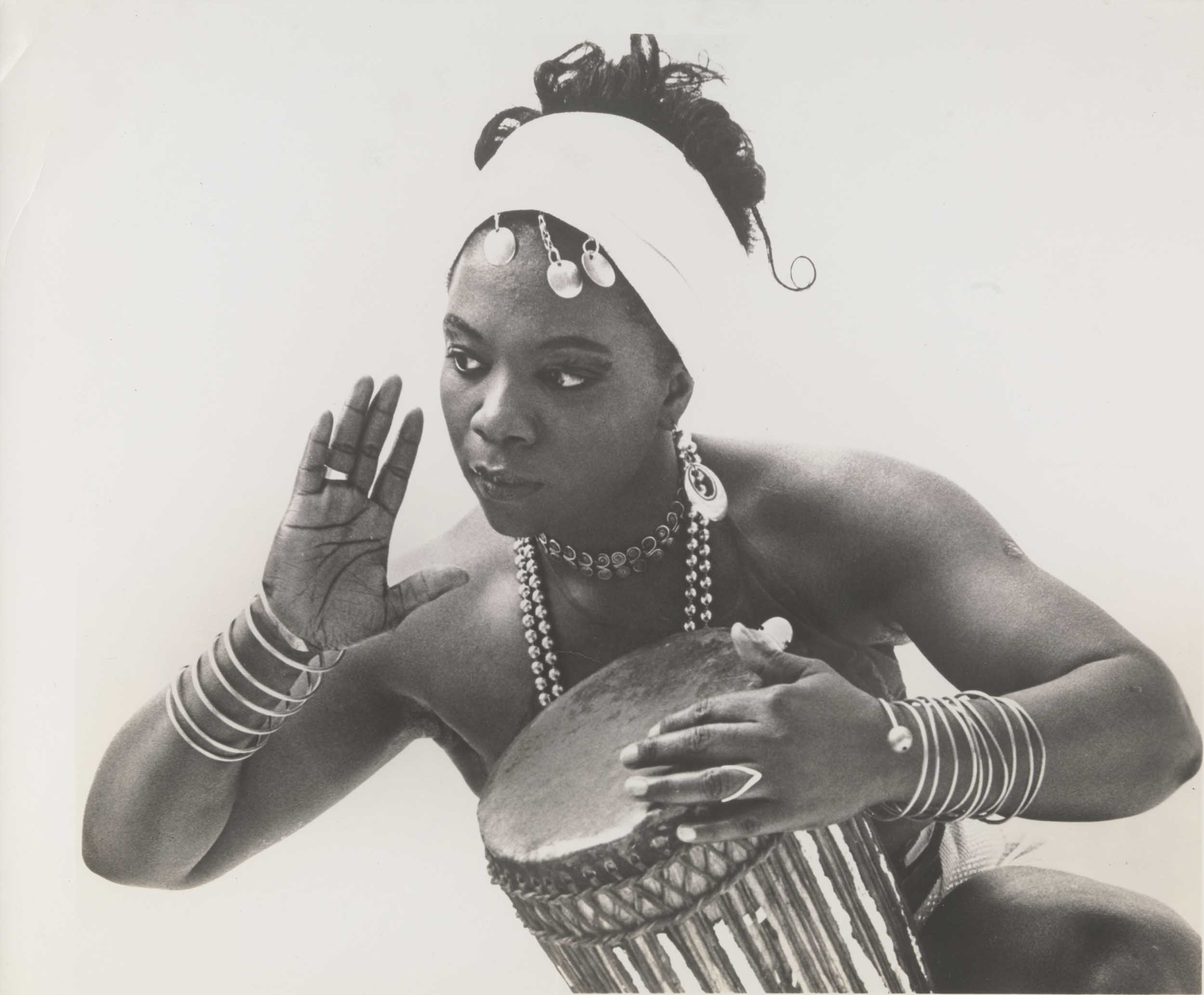 Pearl Primus, dancer performs with a hand drum