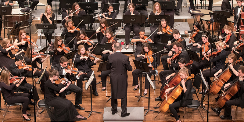 orchestra led by a conductor
