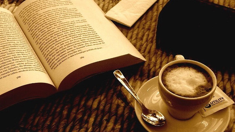 book and coffee on table