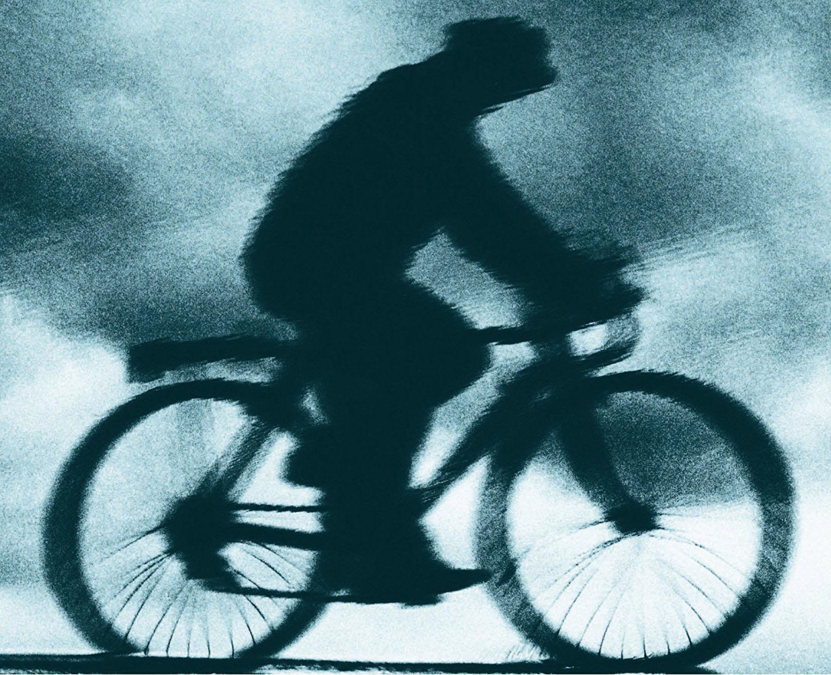 Blurred photo of person on bicycle