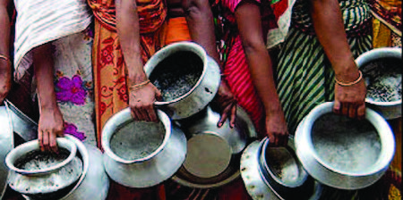 Indian women holding empty cermanic pots