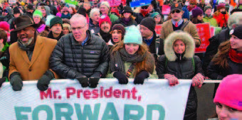 Bill McKibben in a crowd protesting climate justice