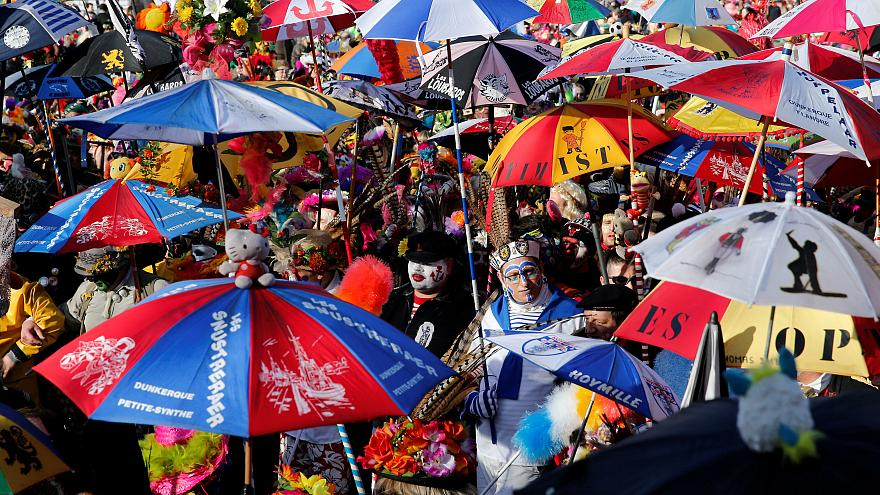 Carnival with painted faces and multi-colored umbrellas