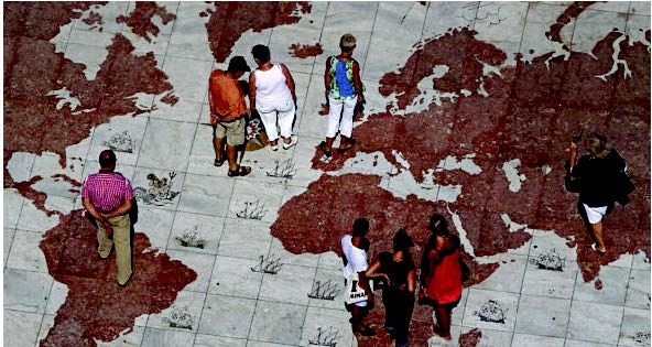 map of the world with people walking across it
