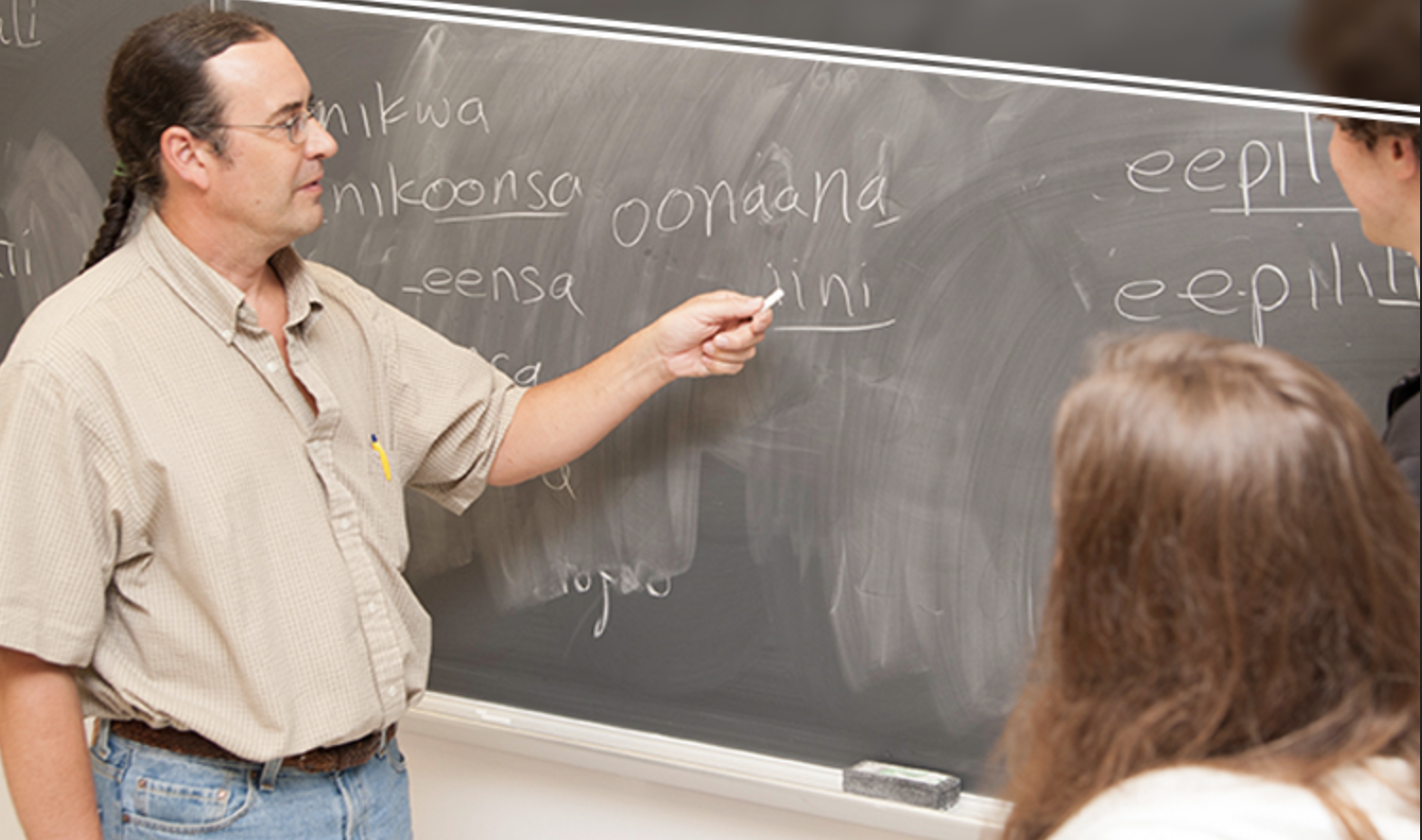 Daryl Baldwin pointing at a blackboard