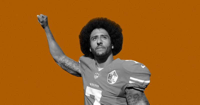 Colin Kaepernick with fist raised