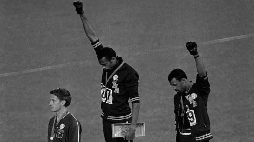 1968 Black Power Olympic Protest: 2 Olympians on podium with fists raised in air