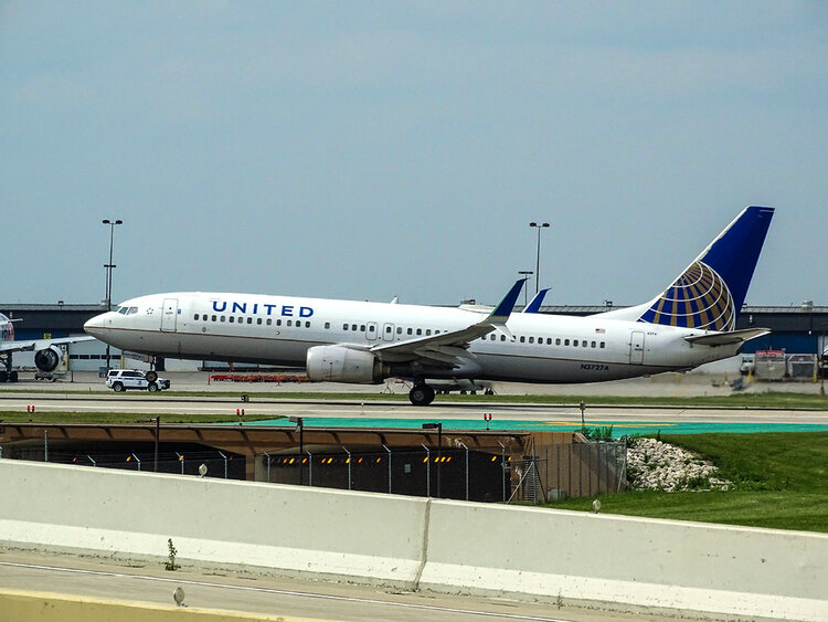 United Airlines plane on the runway.