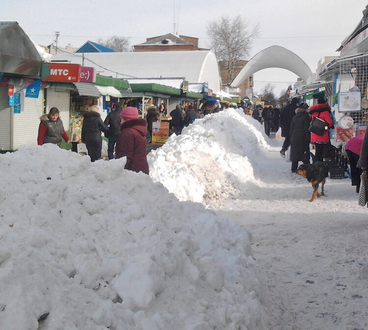 Snow piled higher than some people in Ukraine, March 2013.