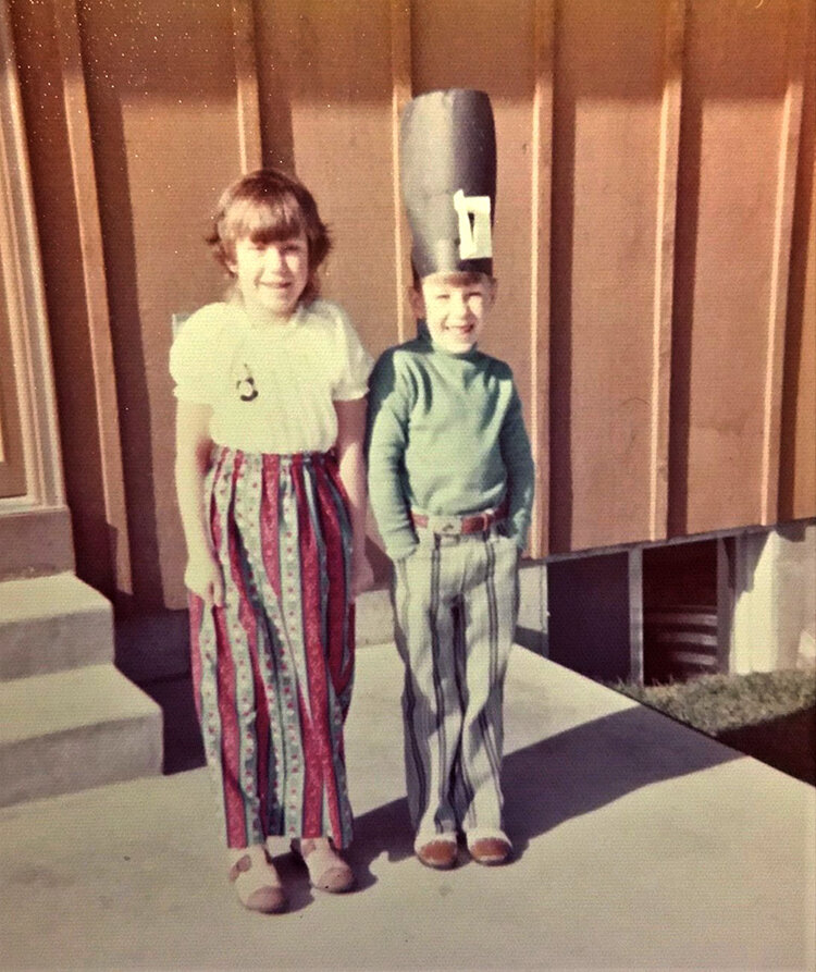 Dave and his sister as children during Thanksgiving, during which Dave insisted on wearing the construction paper hat he made at school.