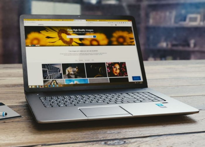 Open Laptop with Images and Informational Text