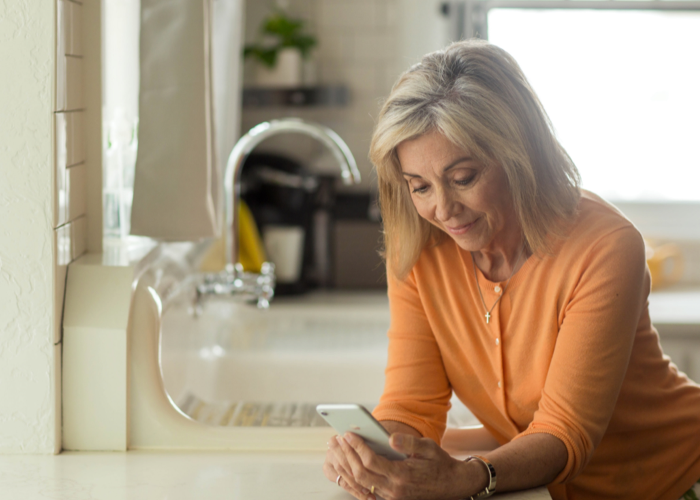 patient using her mobile device