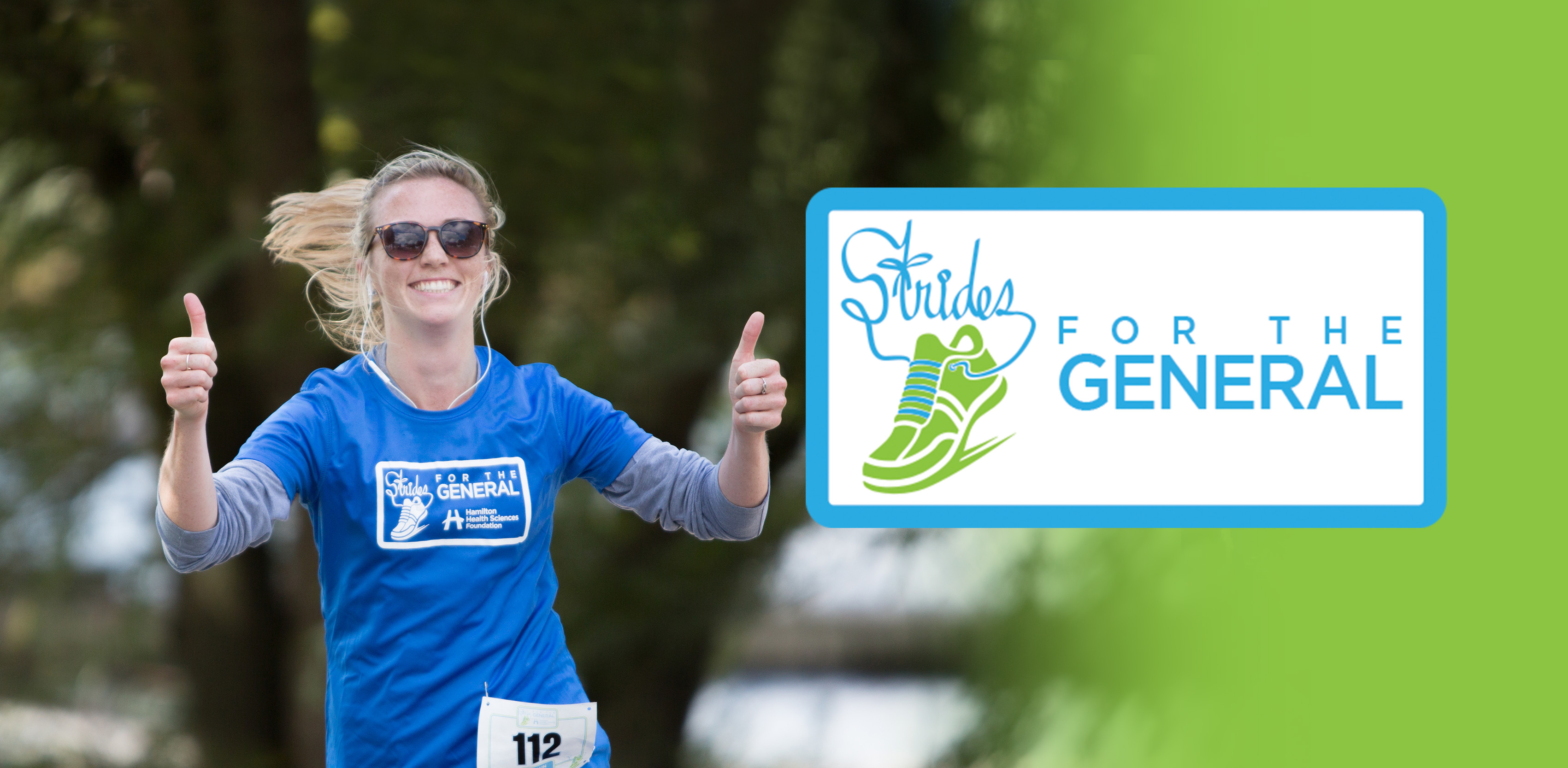 A runner gives two thumbs up with Strides logo