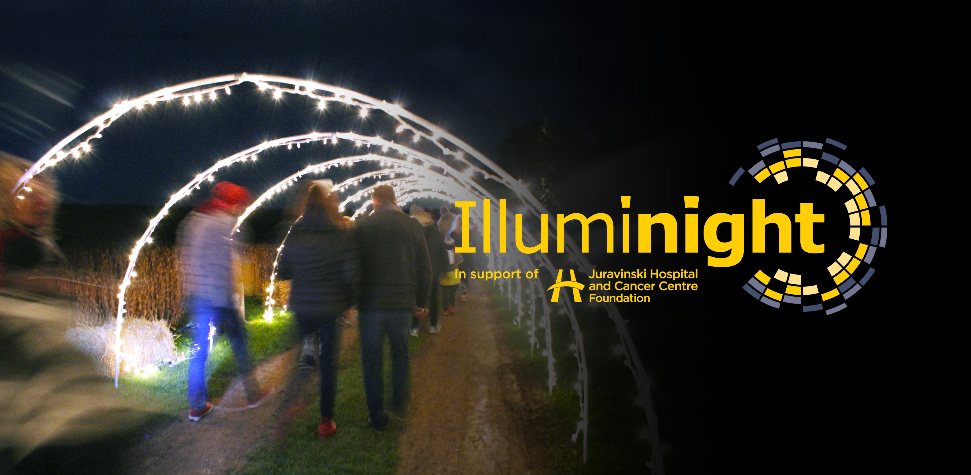 Image of lights on a night walk with the Illuminight logo