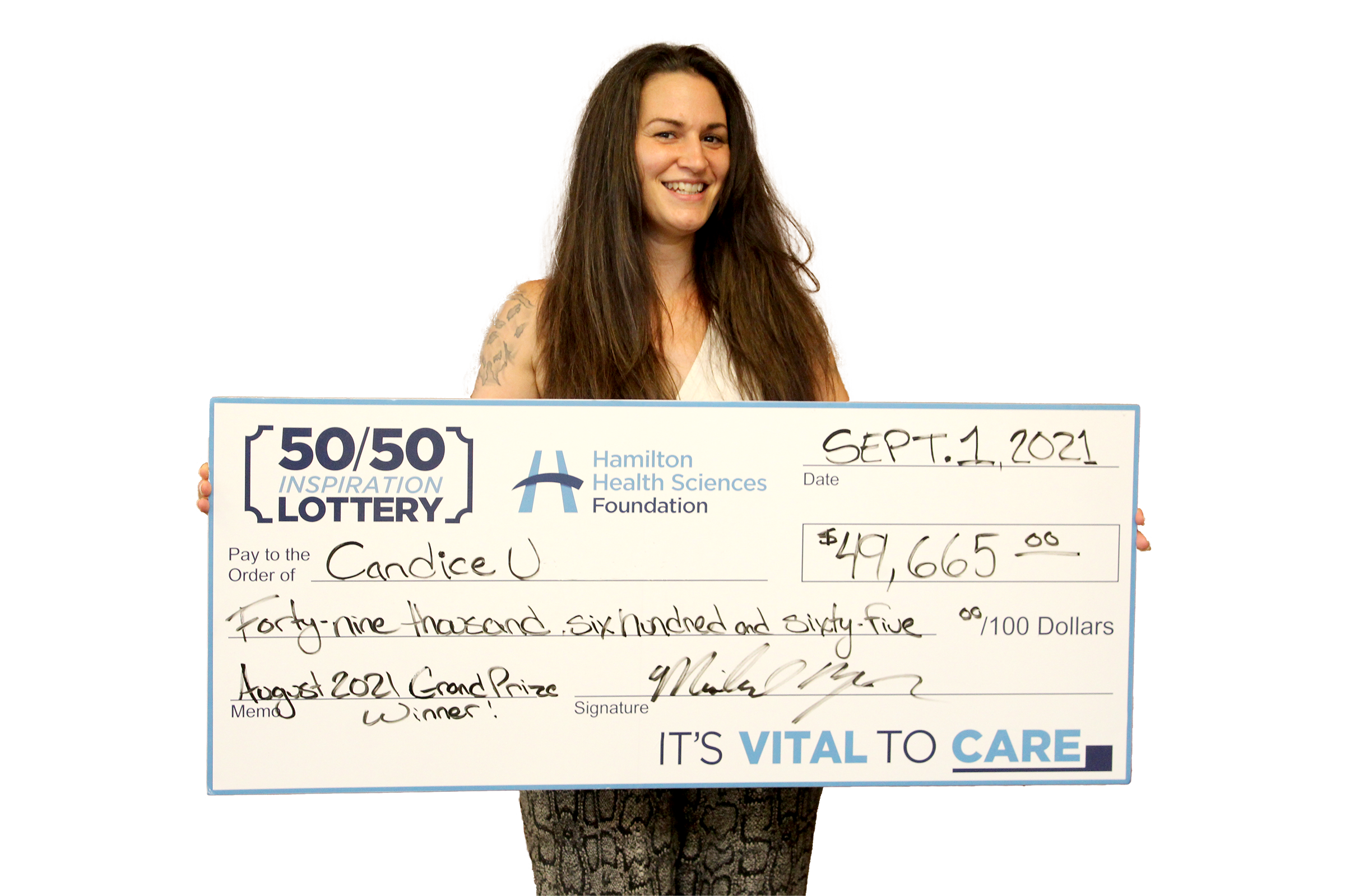 Inspiration Lottery winner Candace U. with her giant cheque.