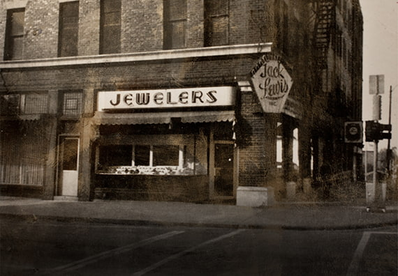 exterior sepia toned photo of the original Jack Lewis Jewelers in downtown Bloomington on the corner of Jefferson