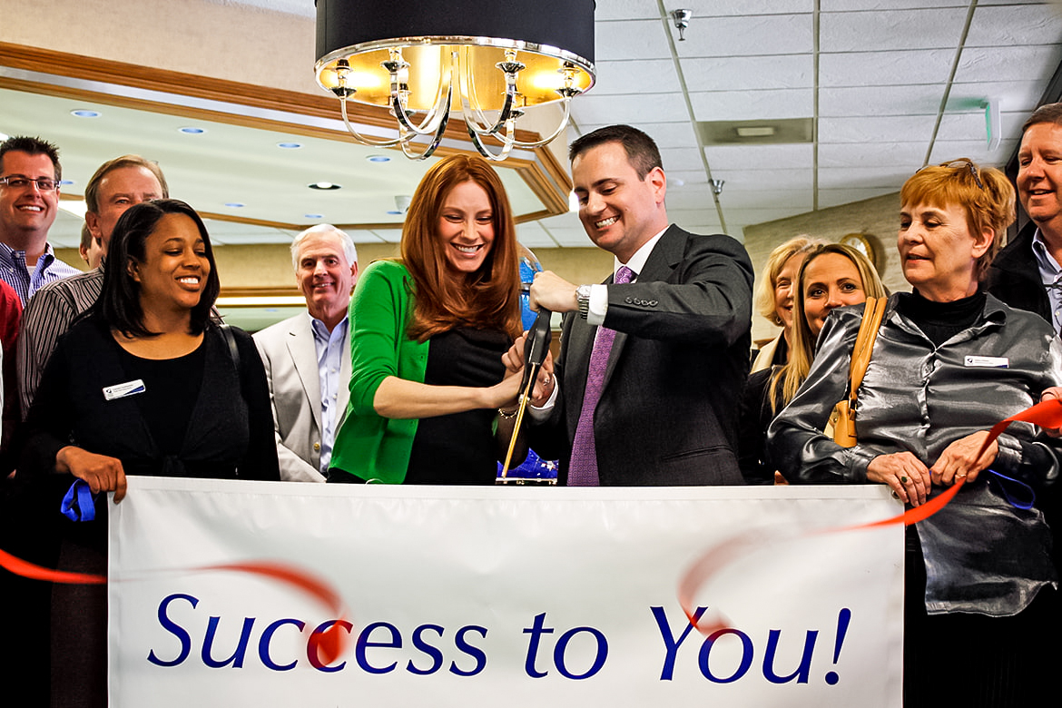 CEO John Carter and his wife Ketty cutting the ribbon with the McLean County Chamber in 2011
