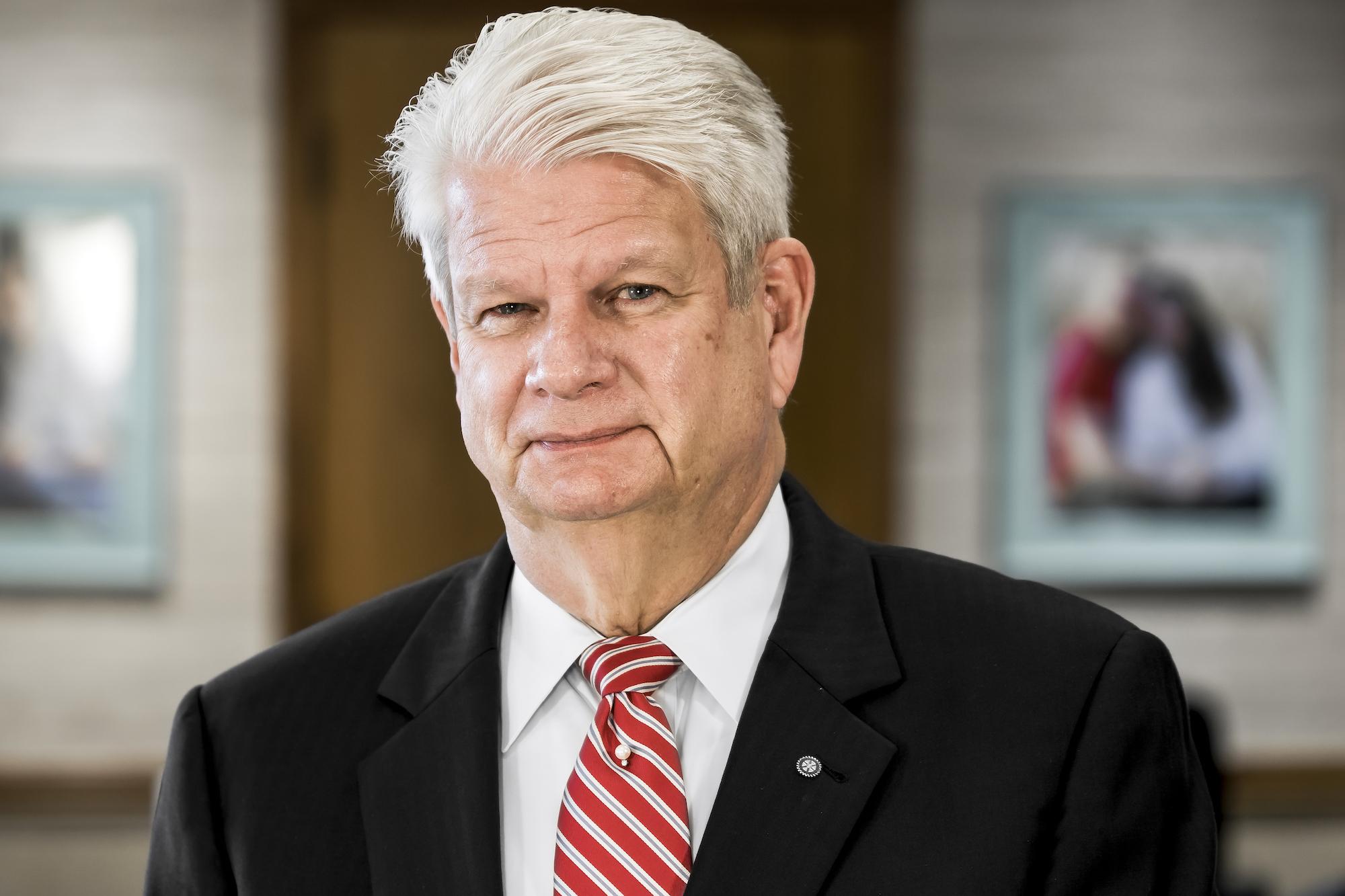 headshot of previous CEO John Wohlwend