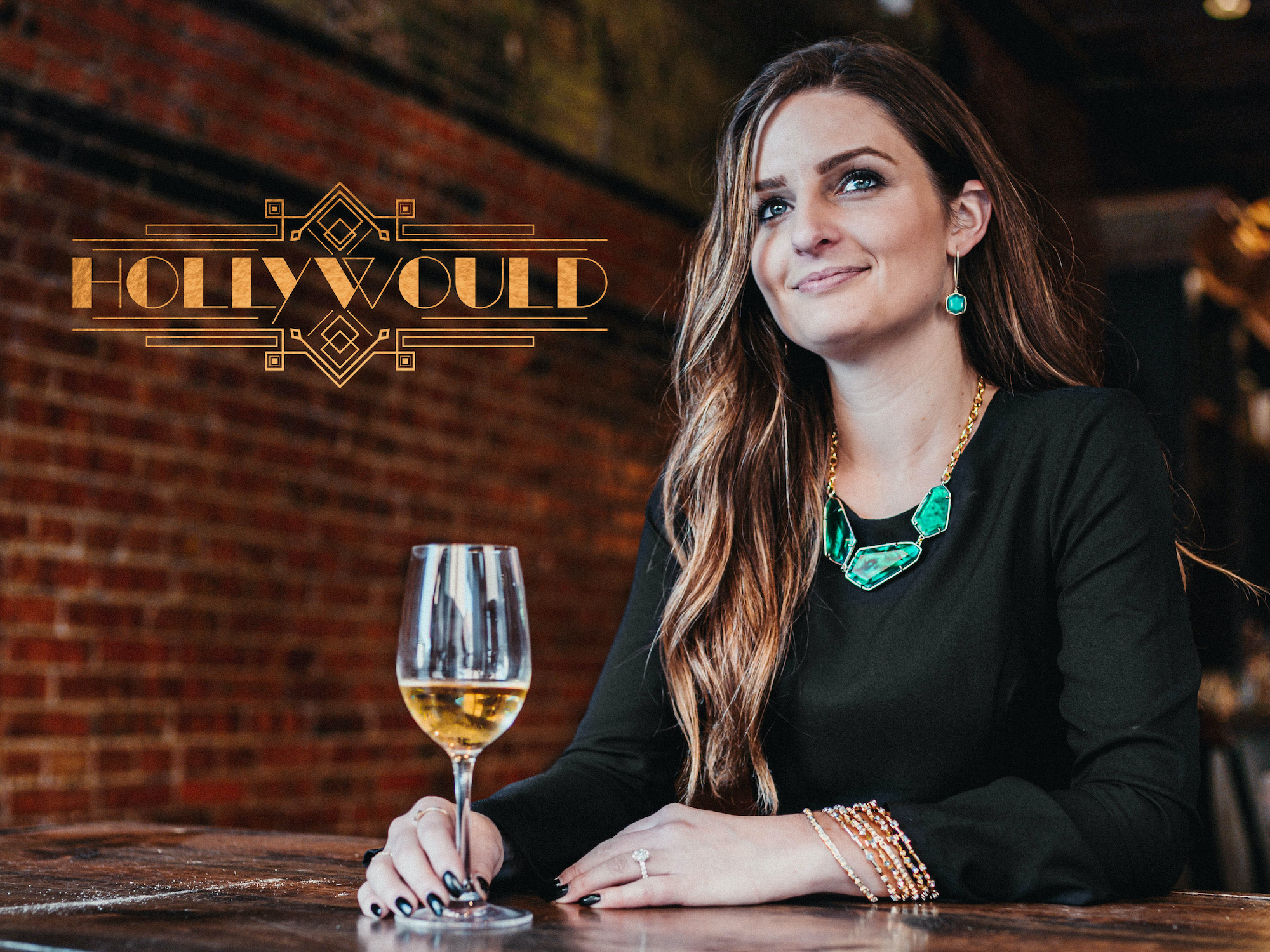 Headshot of team member Holly next to the Hollywould logo with a glass of white wine