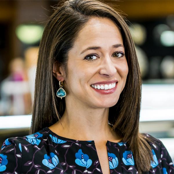 sales manager Missy wearing a pair of teal teardrop earrings