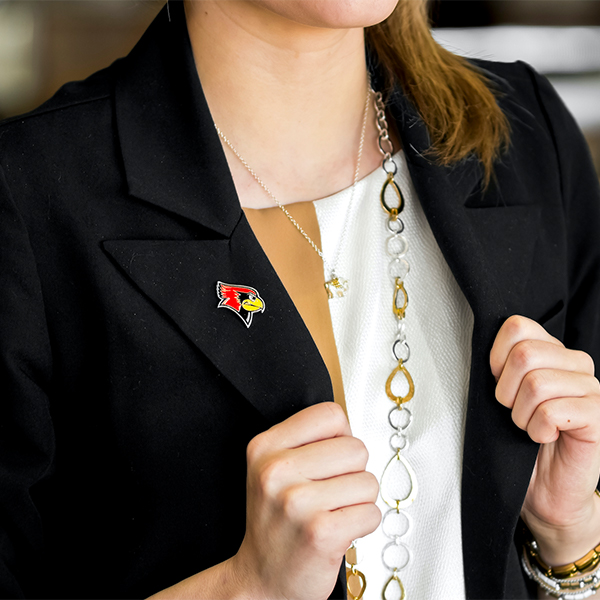 Reggie the Redbird pin on a black woman's blazer
