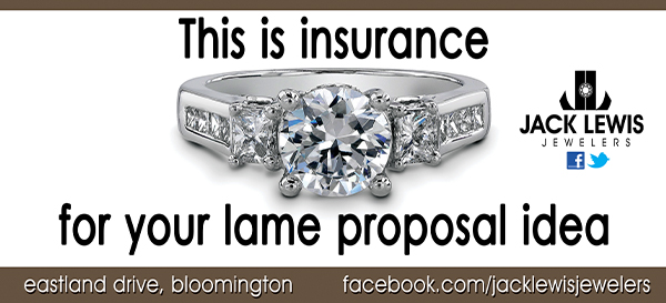 """An advertising campaign billboard from 2011 that features a  diamond engagement ring and says """"This is insurance for your lame proposal idea"""""""