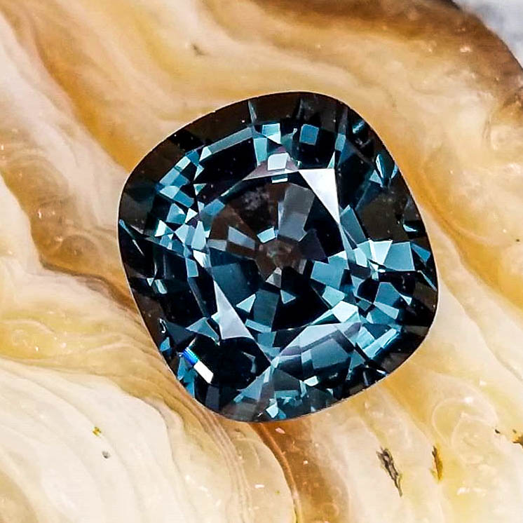 a teal spinel gemstone on display at Jack Lewis Jewelers in Bloomington, IL