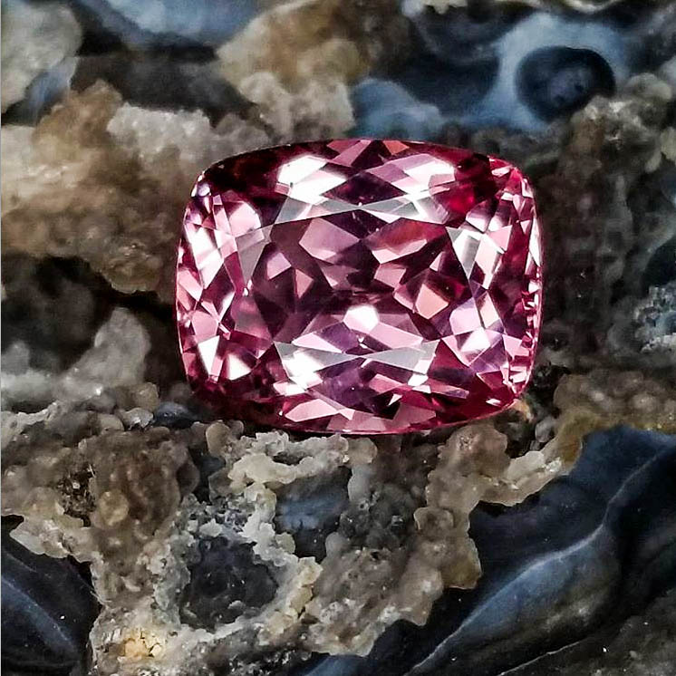 A magenta spinel gemstone on display at Jack Lewis Jewelers in Bloomington, IL