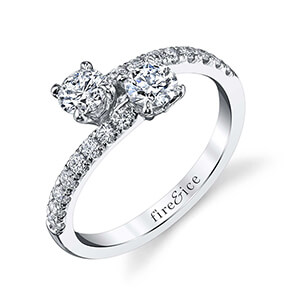 white gold diamond ring with two ideal cut round diamonds that cross over one another, with diamonds along the entire band