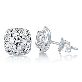 white gold diamond stud earrings with ideal cut round diamonds at the center and a halo of ideal cut diamonds surrounding each