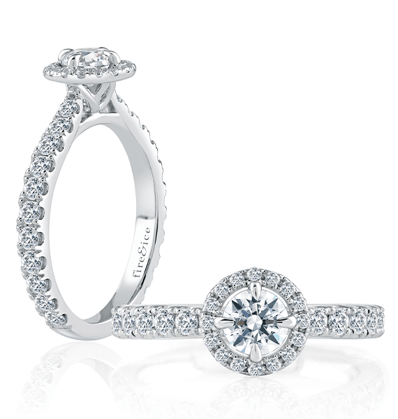 diamond engagement ring in white gold with a round ideal cut center stone diamond, surrounded by a halo of ideal cut diamonds and smaller ideal cut diamonds along each side of the band of the ring