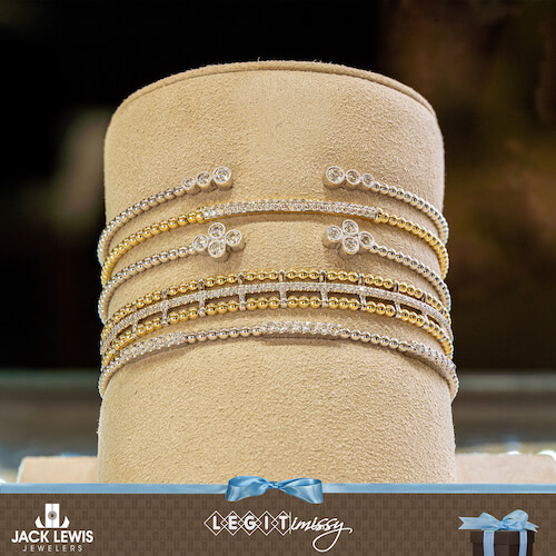Gabriel and Company Bujukan Collection. Multiple stacked bracelets with various types of gold, some with and without diamonds