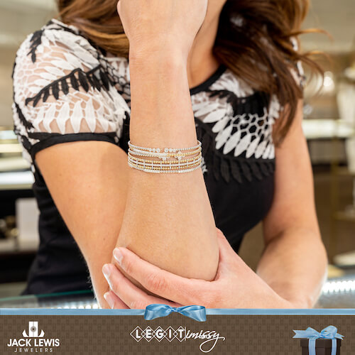 Gabriel and Company Bujukan Collection. Missy wearing multiple stacked bracelets with various types of gold, some with and without diamonds