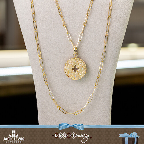 Roberto Coin gold pendant on a gold chain with a matching longer gold chain