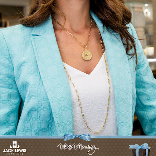 Missy wearing a Roberto Coin pendant necklace in gold, with an additional long gold chain.
