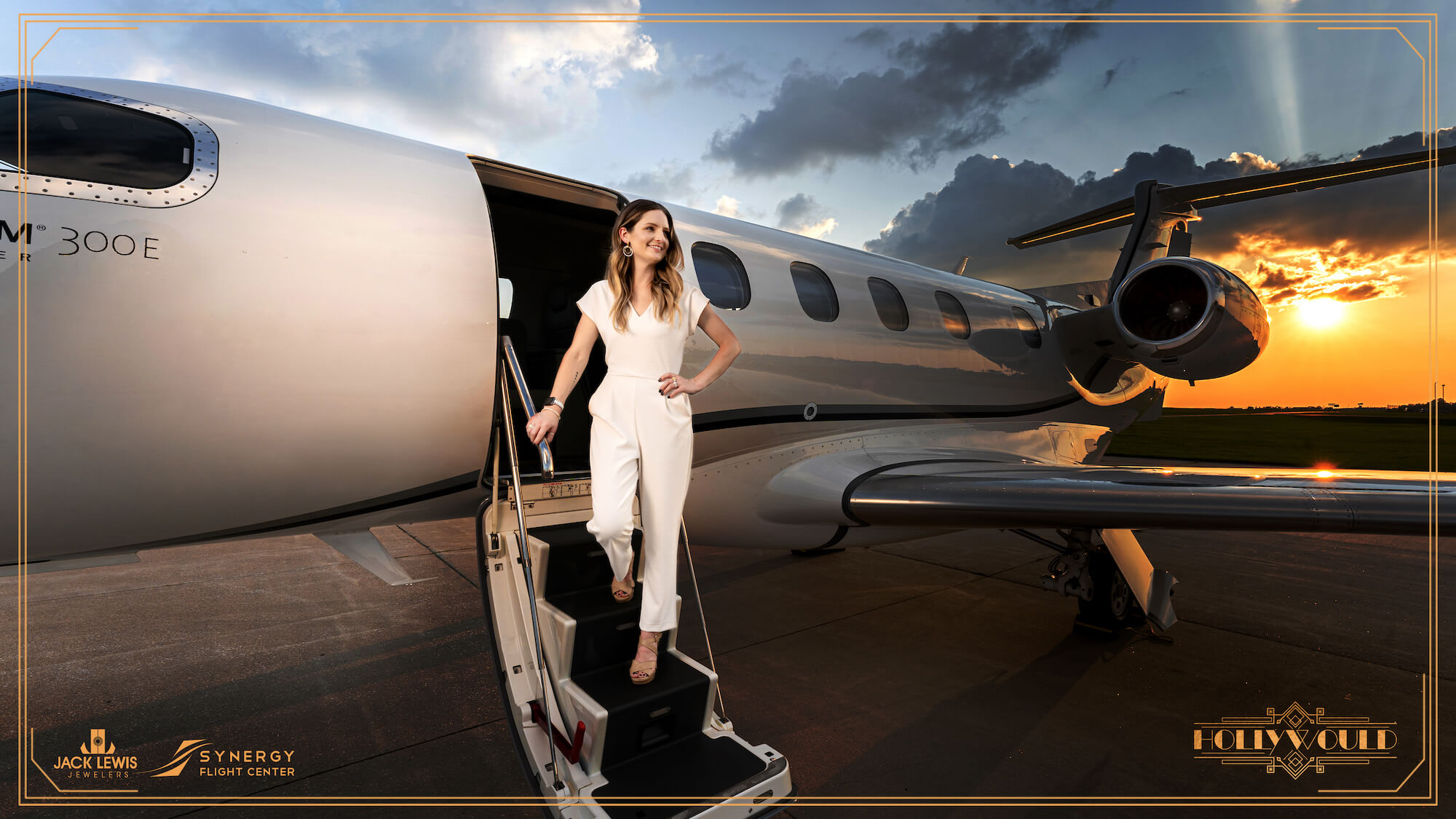 Young woman with long brown hair wearing a white pantsuit, and walking up airplane steps with the sunsetting behind her. She is wearing a bracelet, earrings and rings from the brand Lagos and their caviar collection.