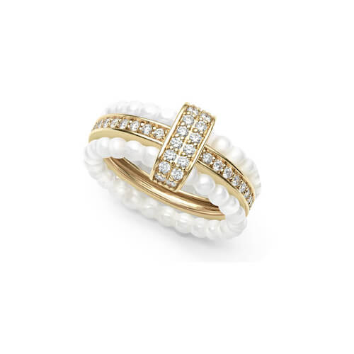 Close up product shot of a LAGOS silver and gold caviar ring with a channel of diamonds