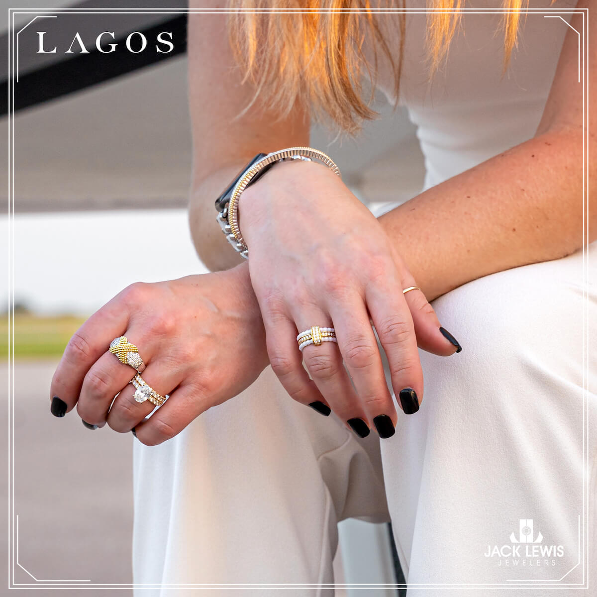 Close up photo of a young woman's hands crossed on top of her knees. She is wearing multiple rings, a bracelet and an Apple watch from the LAGO collection.