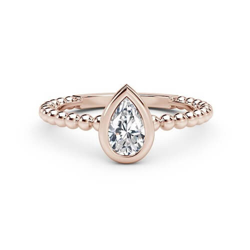 Pear shaped diamond ring set in rose gold from Debeers Forevermark