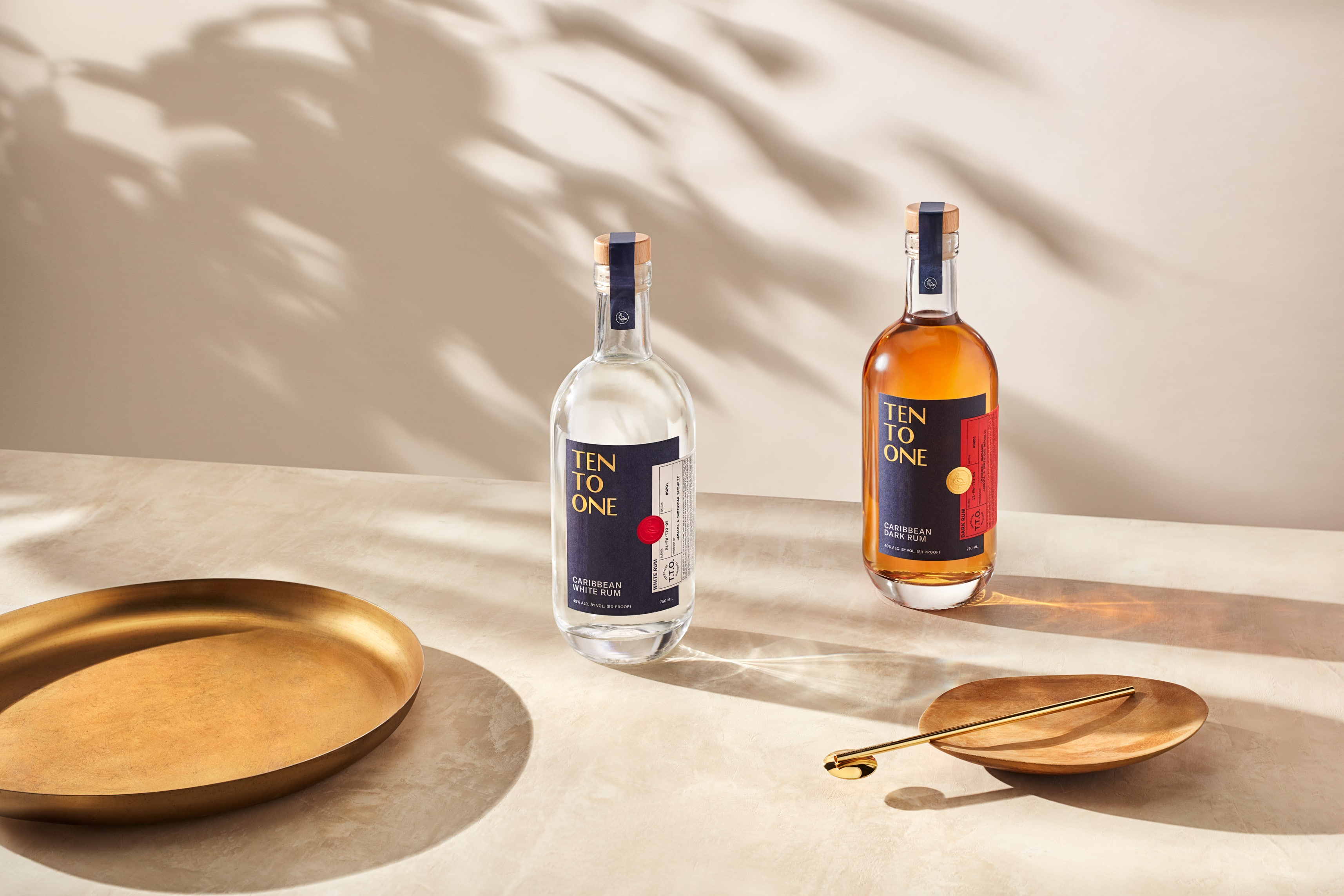 Bottles of Ten to One rum with assorted modern plates