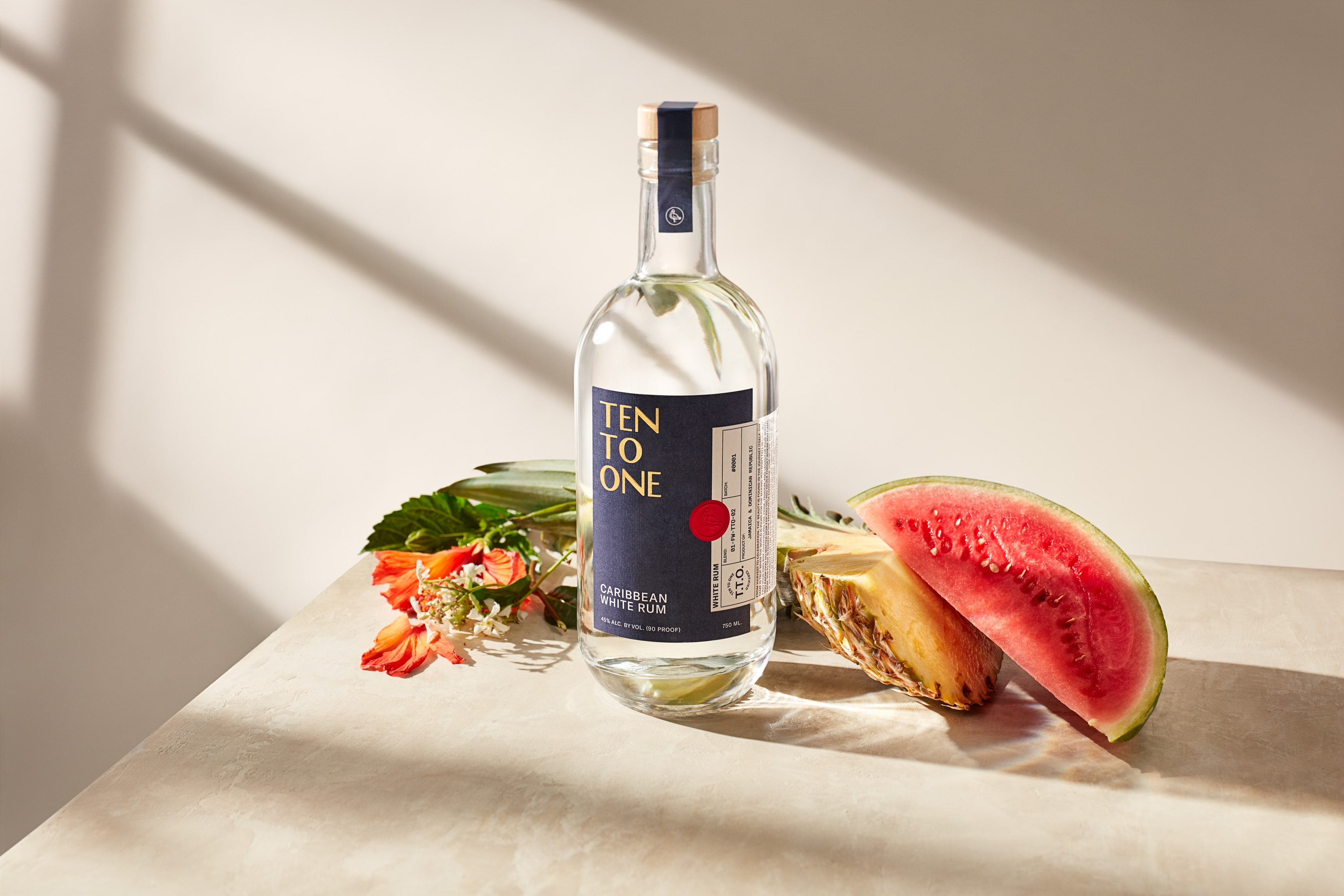 A bottle of Ten to One rum with assorted fruits