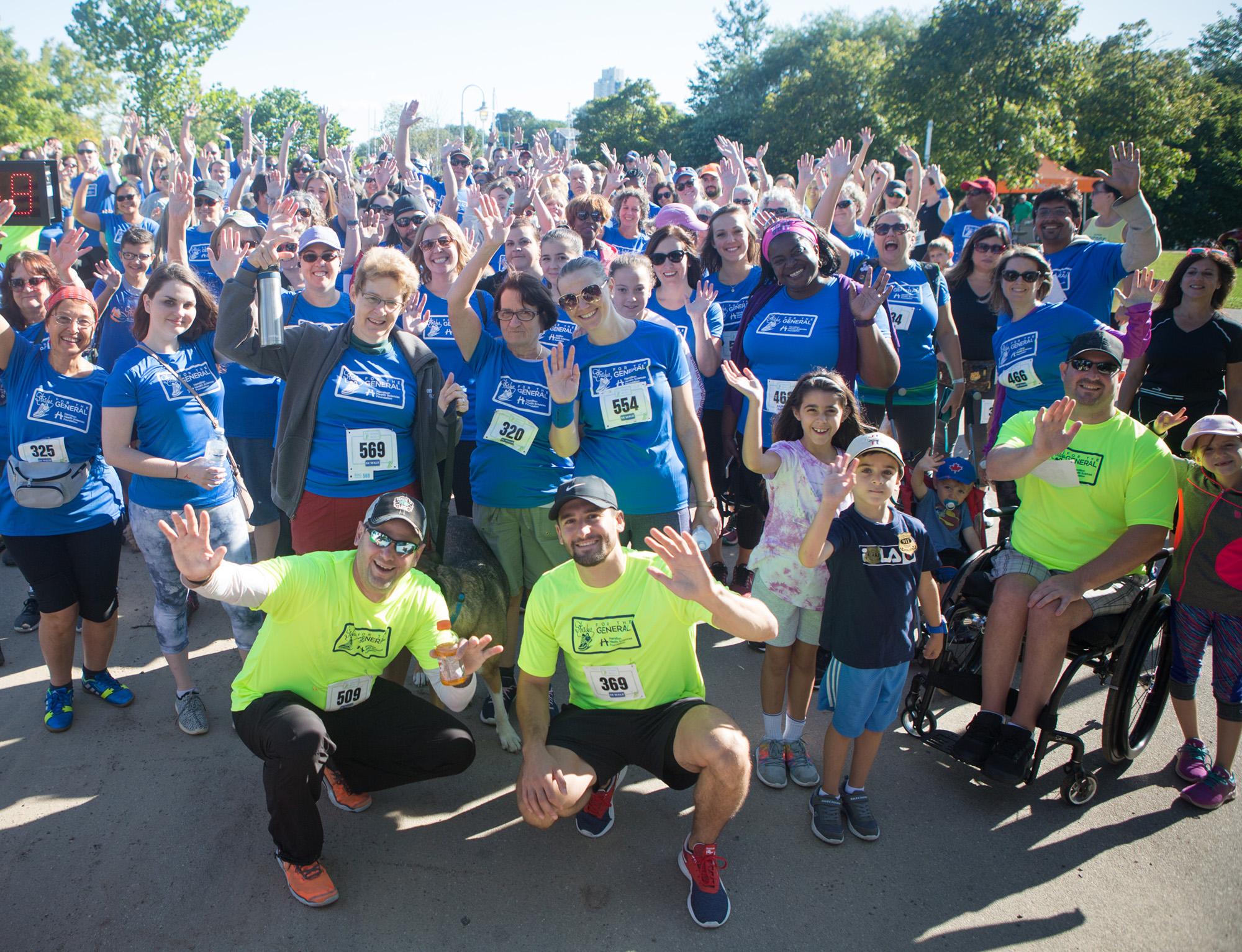 Event participants wave at camera