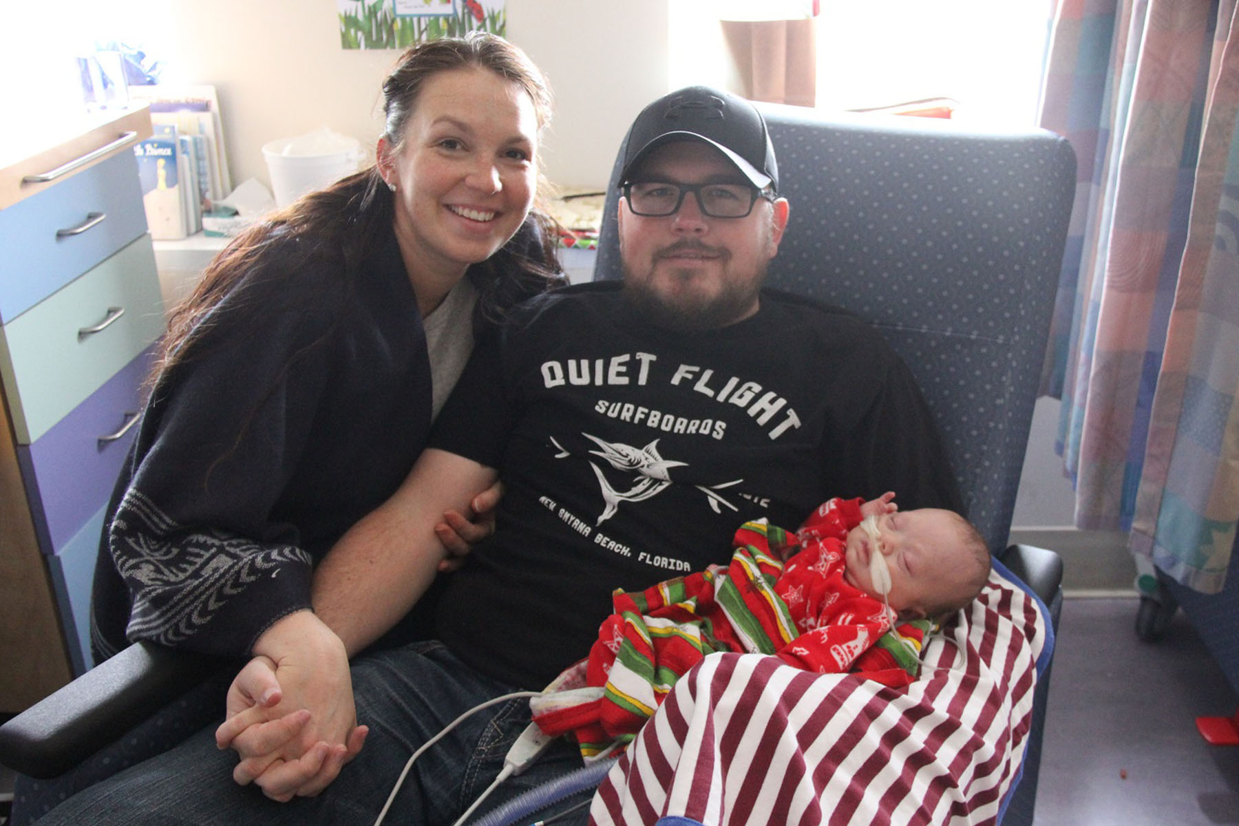 Kim, David and Cayden pose for a photo in a hospital room.