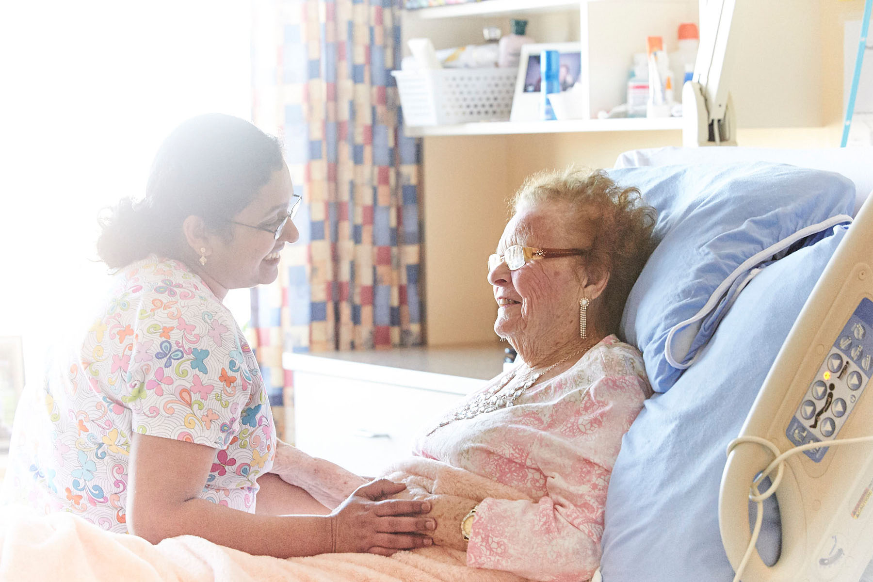 Nurse with an elderly patient