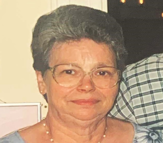 A headshot of Christina