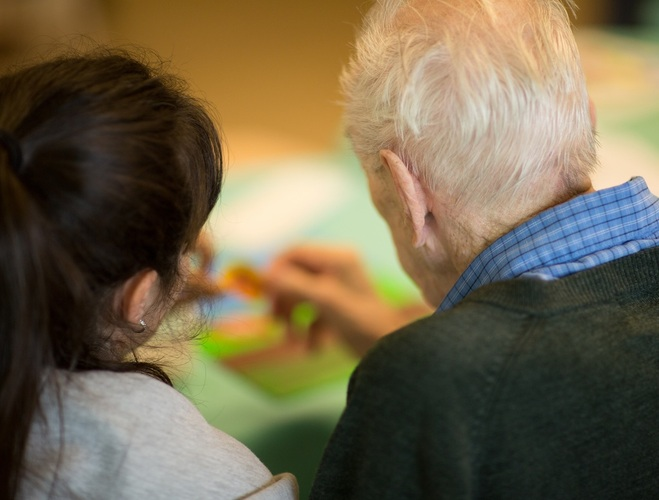 A therapist helps a patient with art therapy