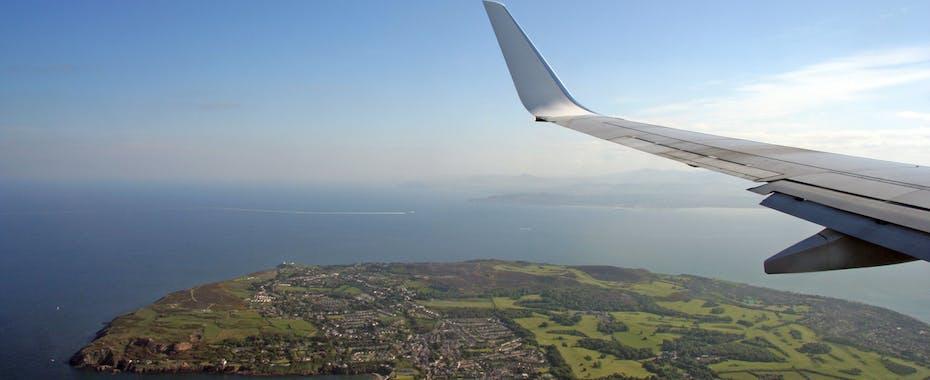 Plane wing over Ireland